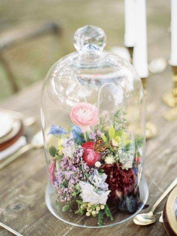 boho bell jar centerpiece with colorful blooms