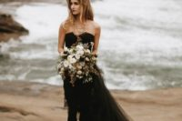 04 the bride in black, a long tulle skirt and a moody bouquet