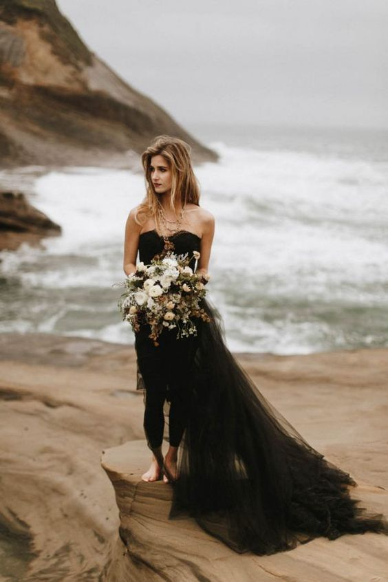the bride in black, a long tulle skirt and a moody bouquet