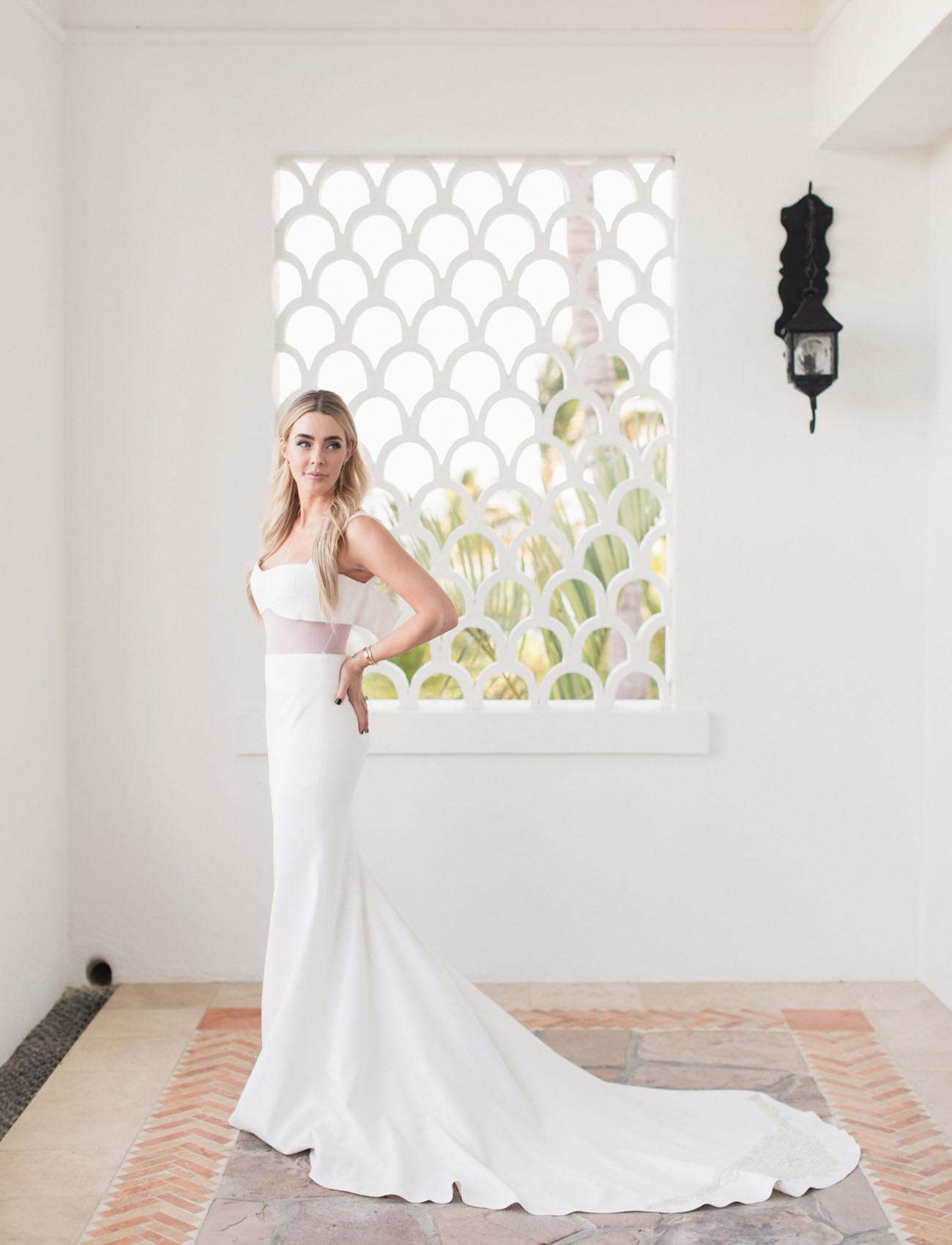 The bride was wearing a gorgeous minimalist Vera Wang dress with a small train and a sheer part