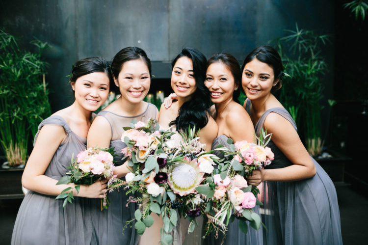 The bridesmaids were wearing mismatched charcoal dresses