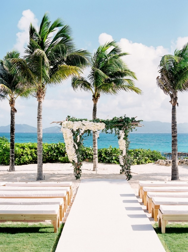The ceremony space was a simple with a beach view, the chuppah was made of driftwood and topped with white flowers and greenery