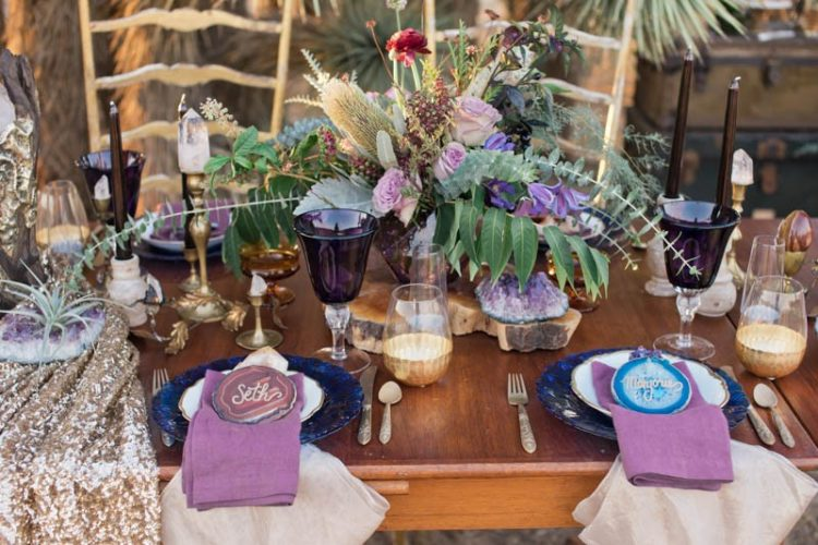 The wedding tablescape was rather bold, with a lilac and red flower centerpiece