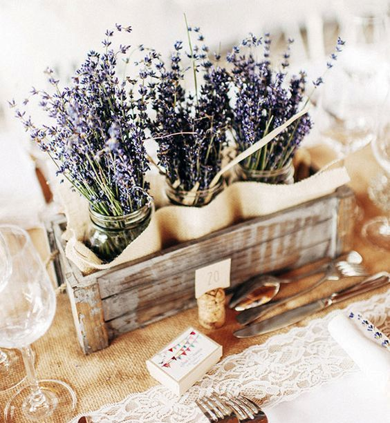 a reclaimed wooden box with mason jars and lavender