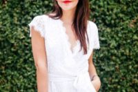 05 a white lace romper with cap sleeves and a V cut