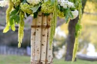05 birch branches secured with twine and hydrangeas on top for the aisle decor