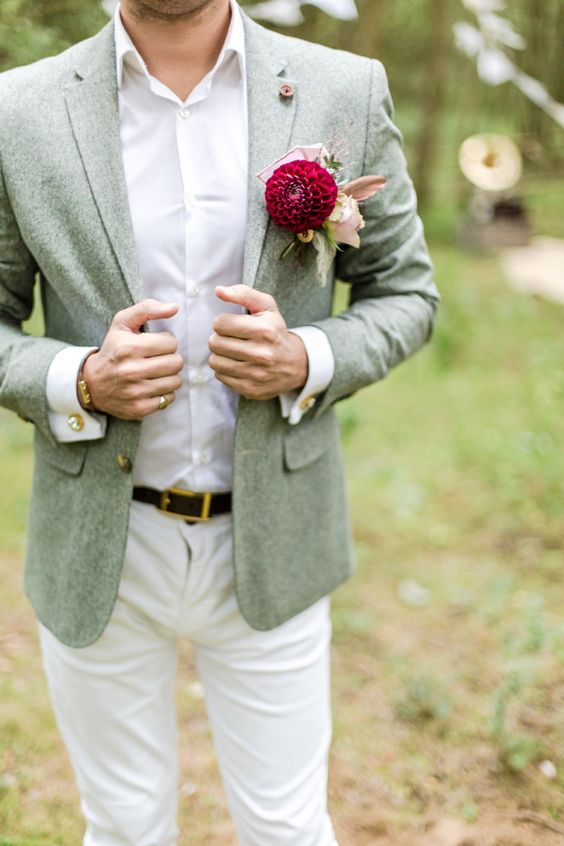 cream pants, a white shirt, a grey tweed jacket
