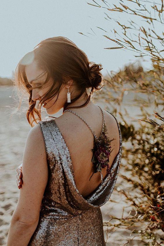 dark jewel-toned wedding dress with a dried flower back necklace