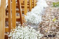 05 line up the aisle with buckets of baby's breath for a cozy look