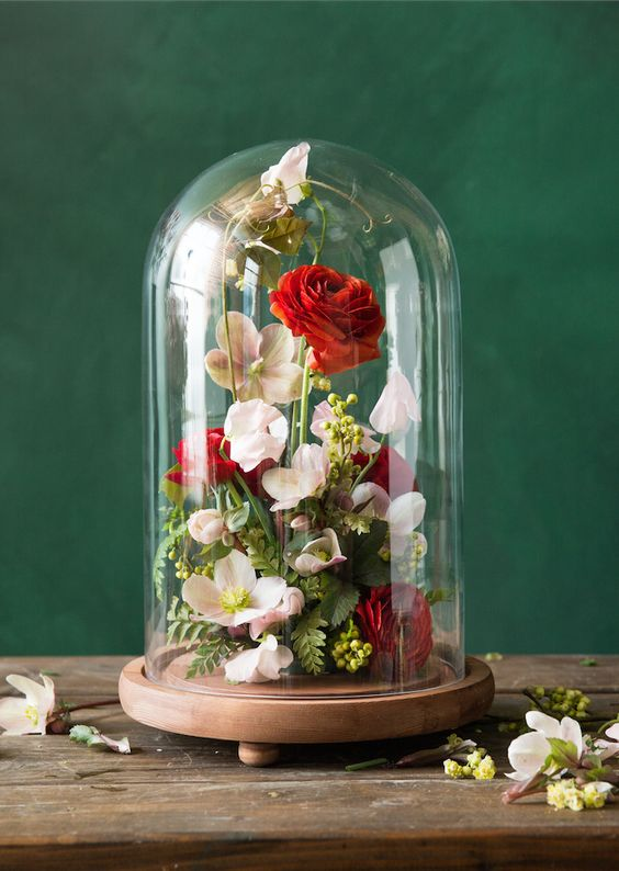 red and pink cloche floral arrangement is gorgeous