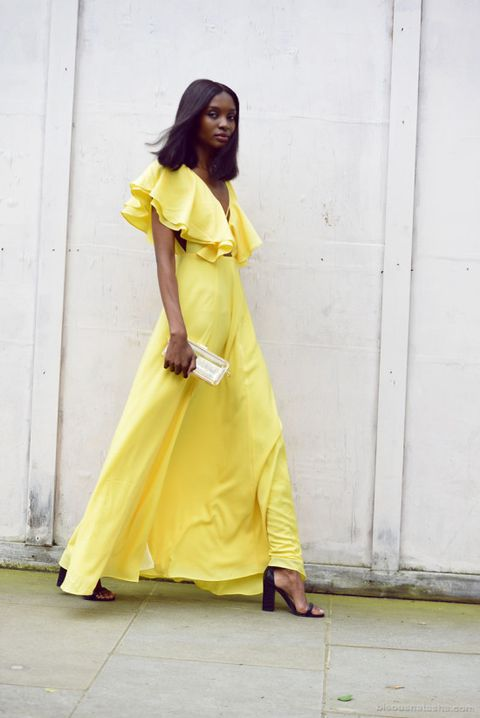 sunny yellow maxi dress with a ruffled bodice and black heels