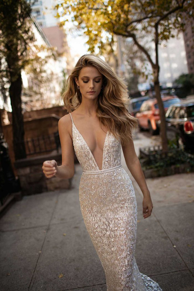 Daring plunging neckline wedding dress on spaghetti straps, with sparkling lace appliques