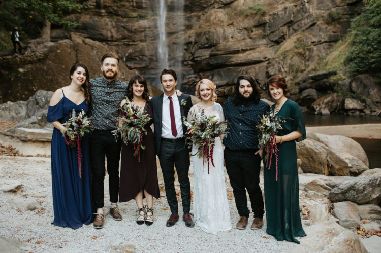 The bridesmaids were wearing mismatched dresses in jewel tones, and groomsmen attire was also mismatched