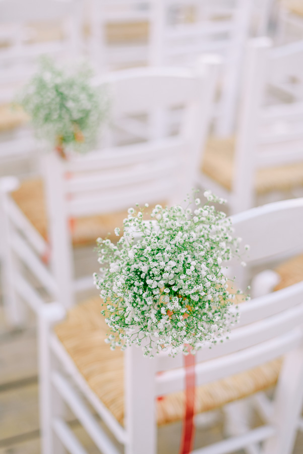 The chairs were decorated with baby's breath