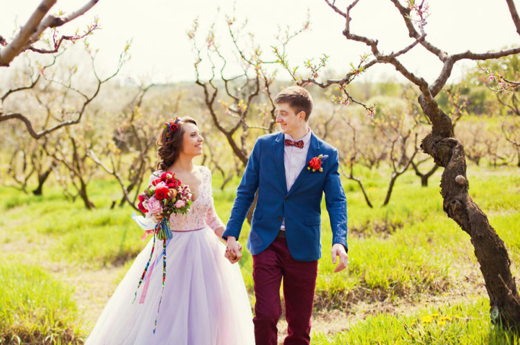 The groom rocked a bold blue jacket, burgundy pants and a bow tie and a white shirt