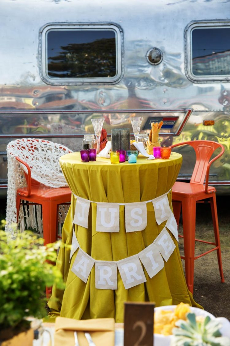 The sweet heart table was a mustard-colored one, with very bold candle holders and crochet covered chairs