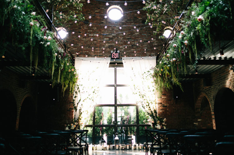 The wedding venue was filled with greenery and chic florals