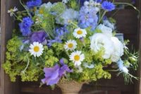 06 a bold purple and green bouquet in a burlap wrap