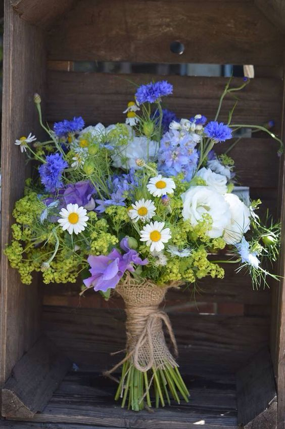 a bold purple and green bouquet in a burlap wrap