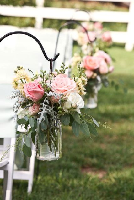 florals and eucalyptus in a mason jar look cute for decorating the aisle