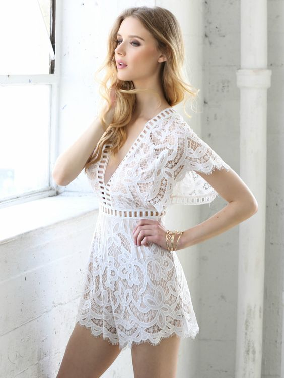 white and nude lace romper with sleeves and cutout details