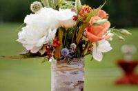 06 wrap vases with birch bark to give the arrangements a rustic look