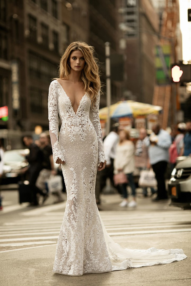 All-lace dress with a plunging neckline with long sleeves and a small train