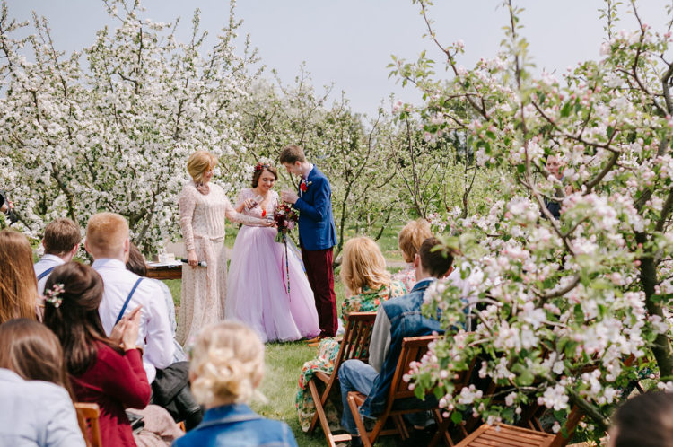 Just look at this stunning ceremony space with blooming apple trees
