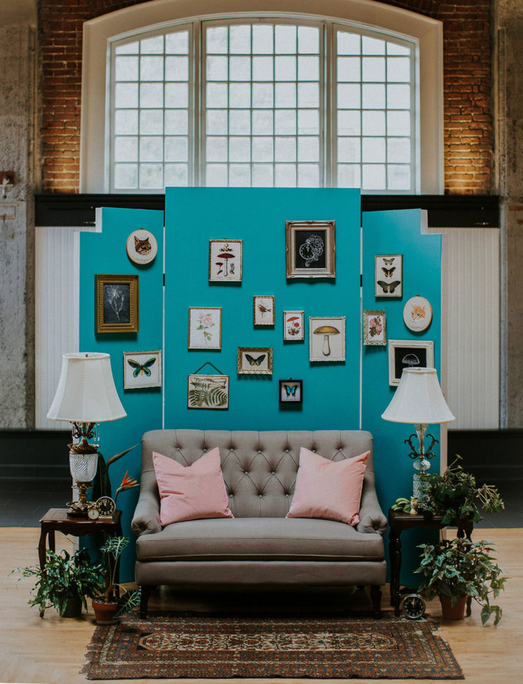 The photo backdrop is perfectly styled, with fun vintage artworks