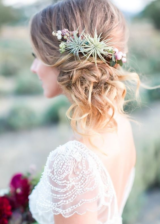 a twisted side updo with airplants because they won't wither
