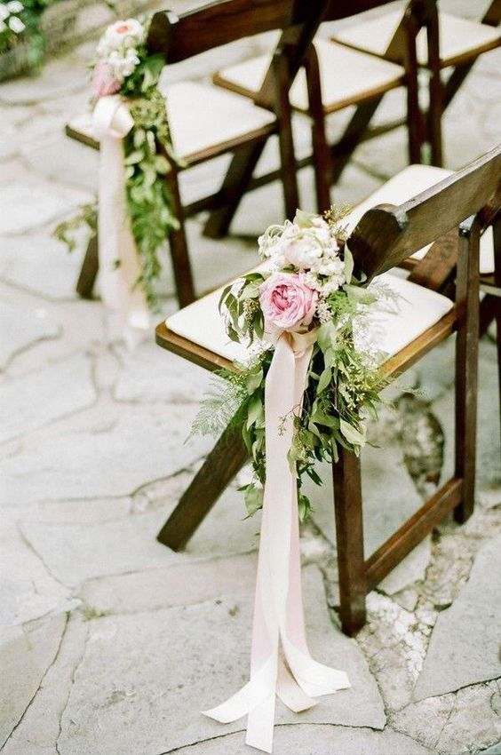 pink roses, messy greenery and neutral ribbon for chair decor