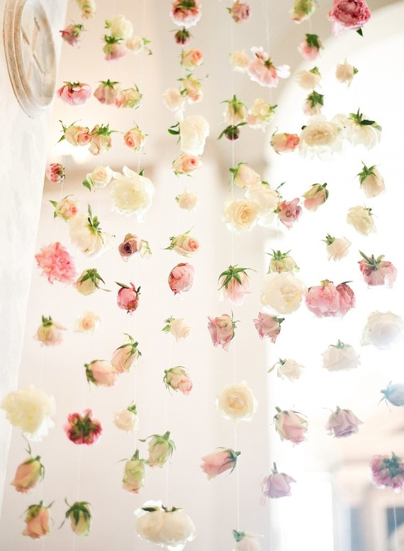 A fresh bloom wall is a nice backdrop idea for such a romantic place