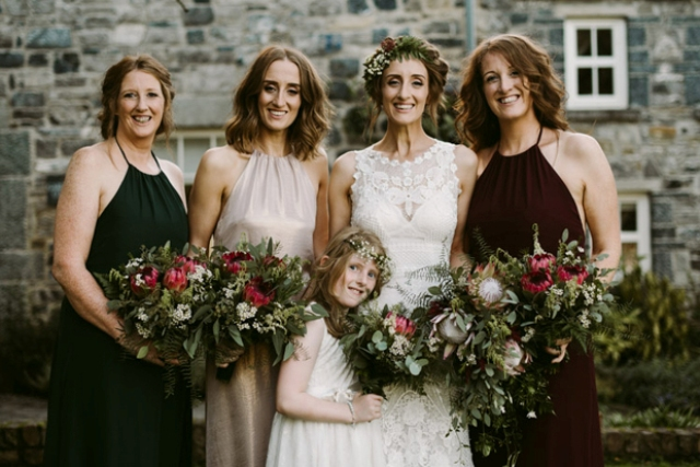 The bridesmaids were rocking different colors of the same dress to express their individuality