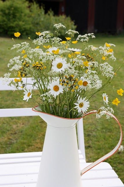 a jug with wildflowers is a great rustic centerpiece
