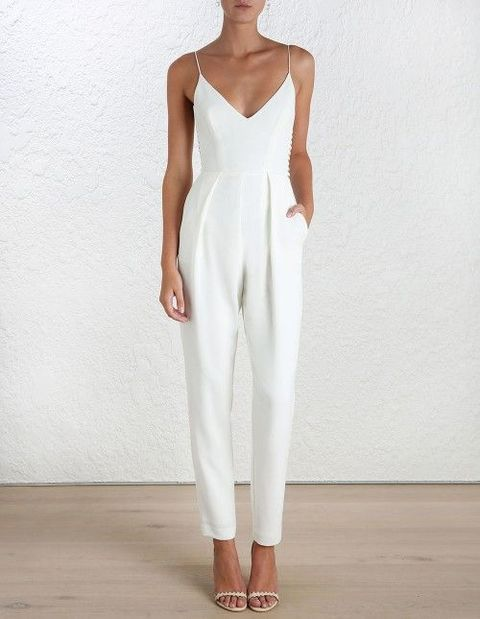 a plain white jumpsuit with a V neckline and thin straps