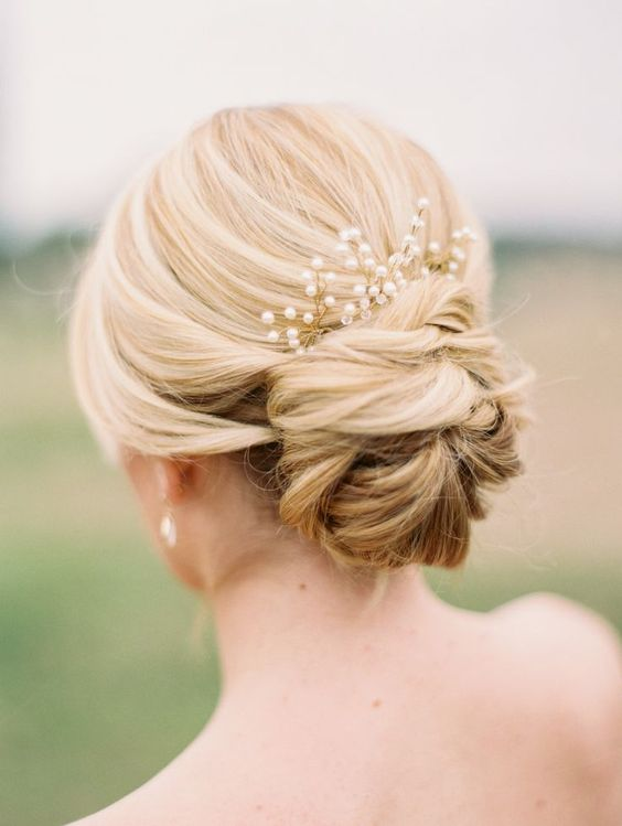 an elegant low bun with a pearl headpiece looks timeless