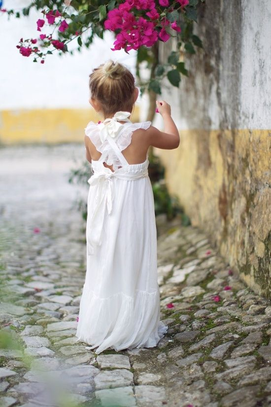 refined boho chic white maxi dress with ruffled criss-cross straps on the back