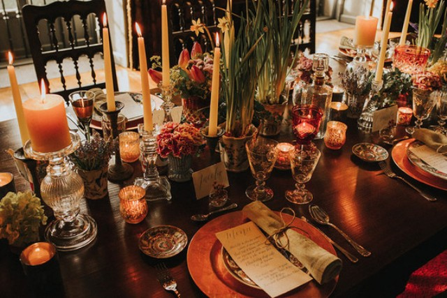 Lots of flowers, greenery, candles and glasses and vintage dishes were used for the reception decor