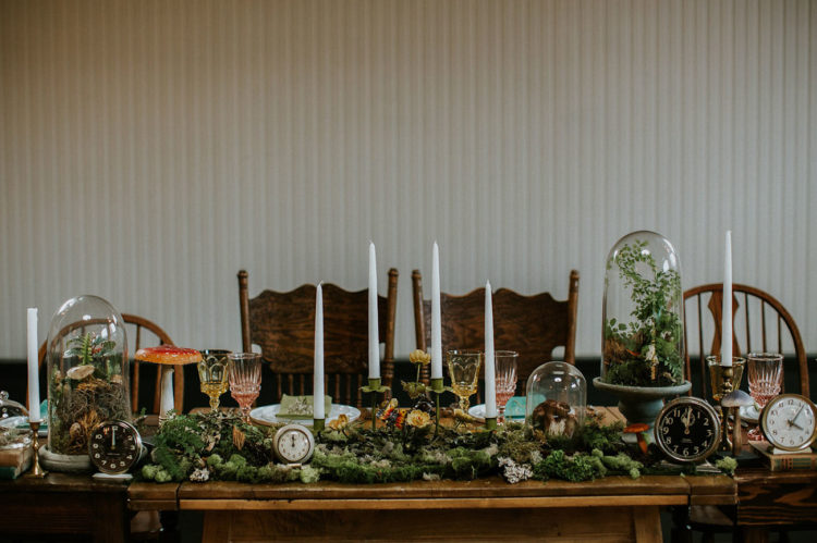 The table was decorated in vintage and woodland style, with lots of moss, greenery, vintage clocks and candles