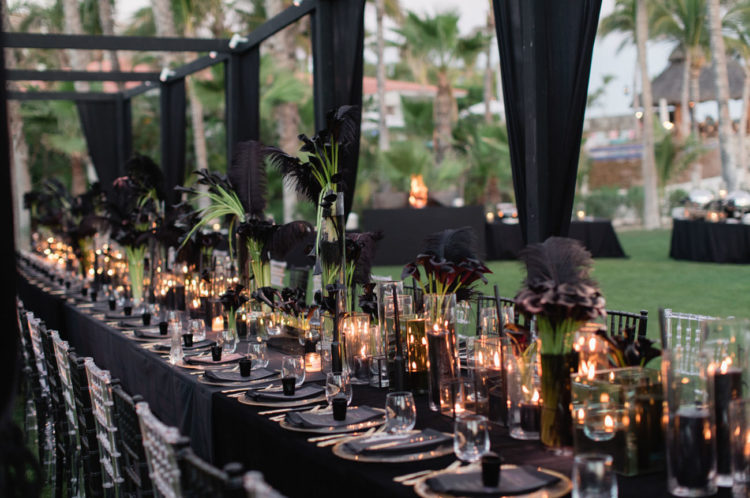 The tablescape was all-black with dark callas, feathers and candles