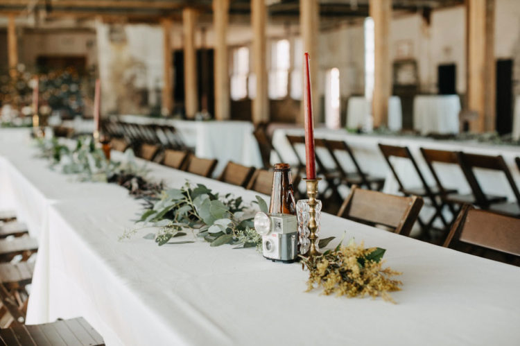 Vintage cameras and candles were used as centerpieces