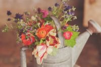 09 a shabby watering can with bold florals for wedding decor