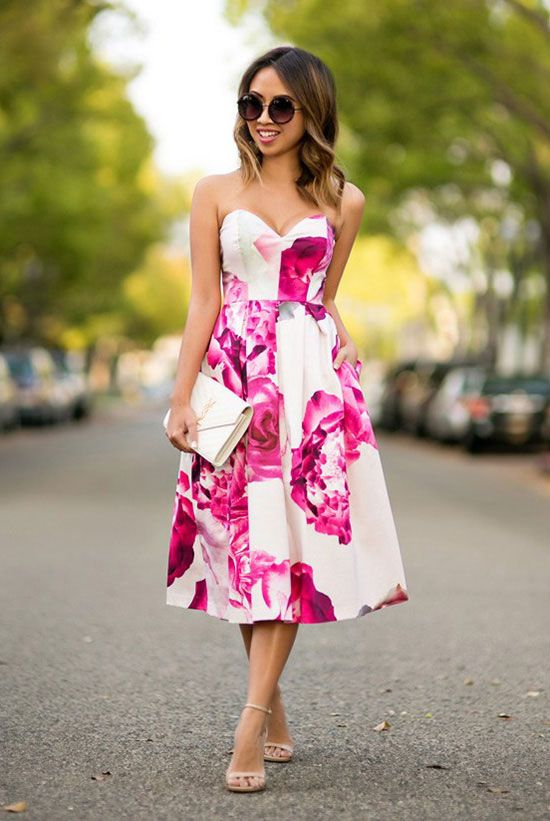 a strapless pink floral print midi dress, nude shoes and a clutch