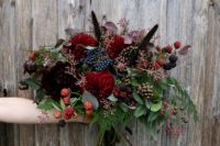 09 a summer bridal bouquet with different berries and red blooms