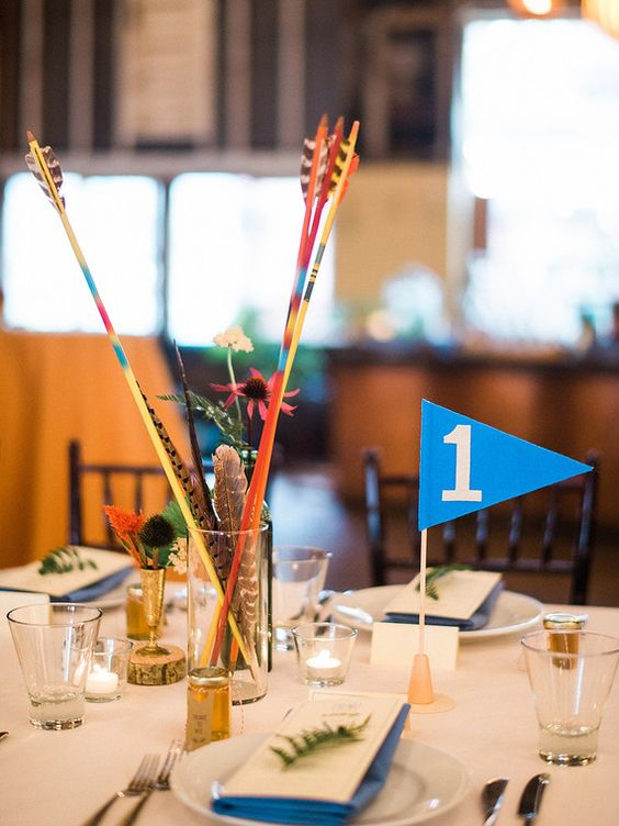 colorful arrows and feathers for wedding table decor