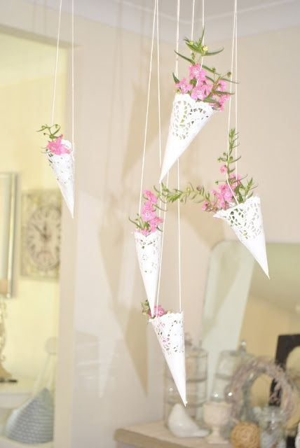 paper doilies with fresh blooms hanging from above is a cute decoration