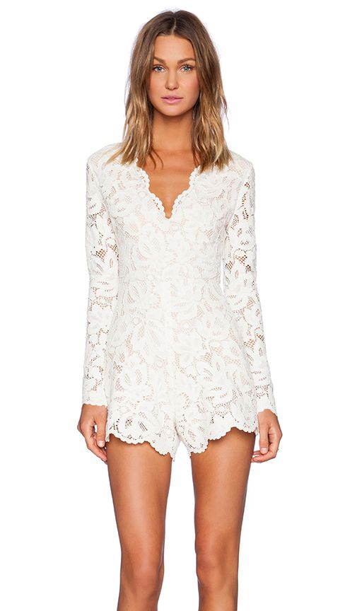 white lace romper with long sleeves and a V neckline
