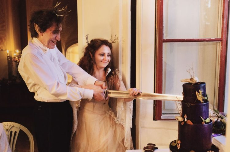Cutting a wedding cake with a sword, yes, please
