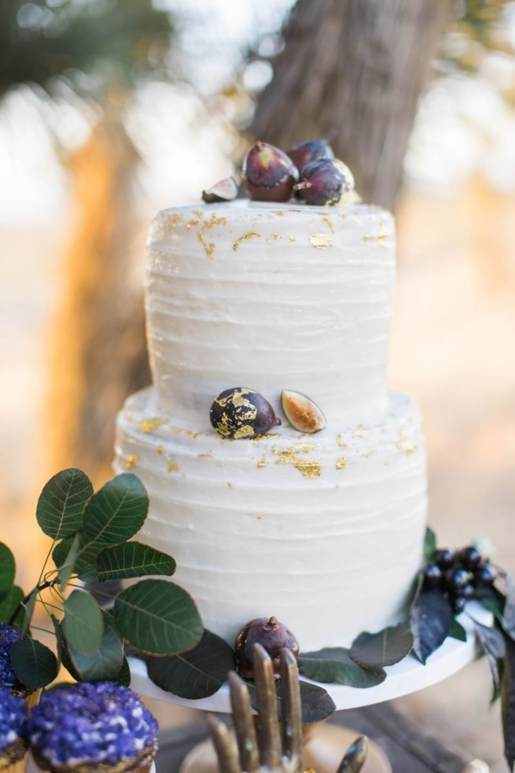 The wedding cake was a gilded one with figs to fit the wedding theme