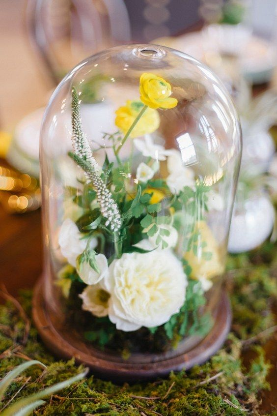 a floral arranegement with white and yellow blooms